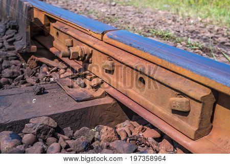 Close Up Detail Of A Rail Track Showing The Steel Track Mounted