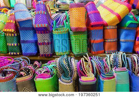 Colorful baskets for sale in a market in Oaxaca Mexico