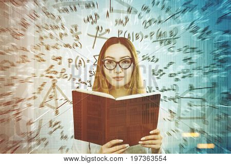 Portrait of an Asian woman wearing glasses and holding a huge open book. She is standing near a gray wall with formulas written on it. Mock up toned image double exposure