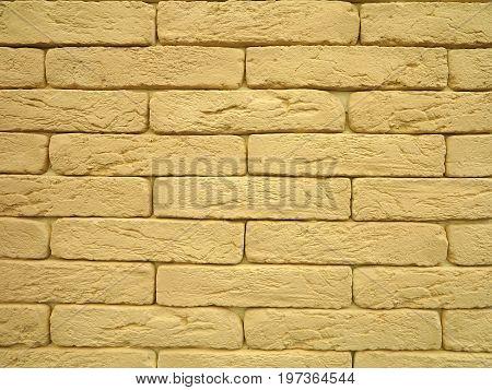 New yellow brick wall texture grunge background.