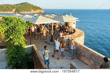 People Chilling Out In Open Cafe At Dubrovnik Fortress Walls