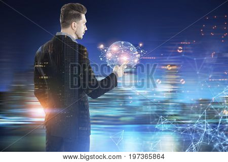 Young bearded businessman looking at his smartphone screen with a tiny Earth hologram and a network in a blurred city. Toned image double exposure mock up.