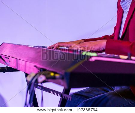 Pianist playing electric piano in concert music concept