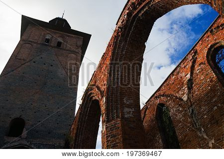 The historical building built of a red brick from the remains of arch apertures and a bell tower. Before destruction there was a Catholic cathedral here