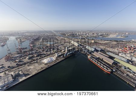 Long Beach, California, USA - July 10, 2017:  Aerial view of Long Beach Harbor with downtown buildings in background.