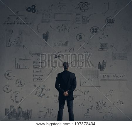 Businessman standing over schematic background. Business and office, concept.