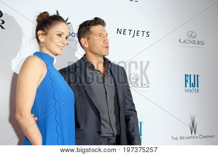 Sarah Wayne Callies and Jon Bernthal arrive at the Weinstein Company's