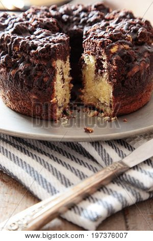 Delicious chocolate coffee cake on table