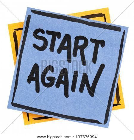 start again motivational reminder - handwriting in black ink on an isolated sticky note