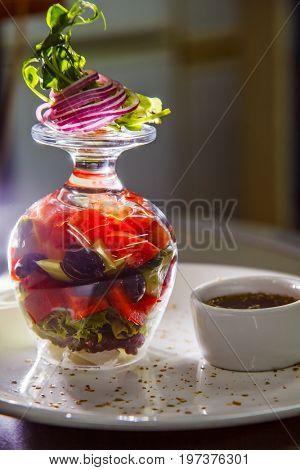 Beautiful, appetizing Greek salad of European cuisine. close-up