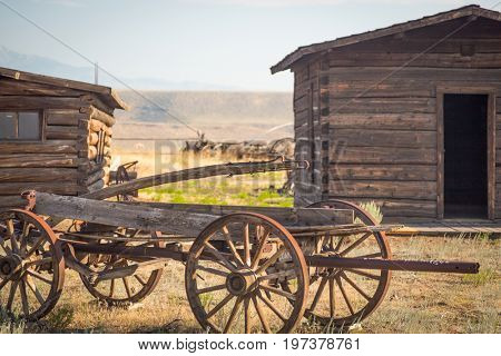 Abstract of Vintage Antique Wood Wagon and Log Cabins.
