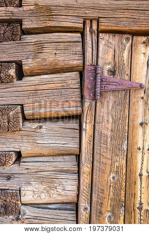 Abstract of Vintage Antique Log Cabin Wall and Door with Hinge.