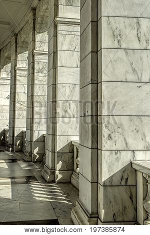 Finely detailed columns bathed in sunlight in Arlington Virginia.