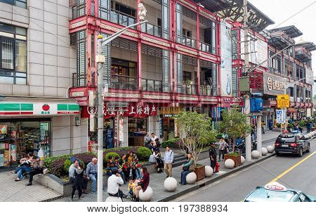 Shanghai, China - Nov 6, 2016: Fangbang Middle Road - Commercial buildings reflect Old Shanghai mood. Image also features people along the street.