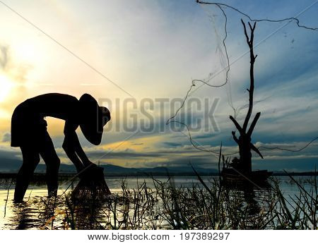 Children Fisherman boy with catching fish and fisherman throwing nets and girl on boat on lake river thailand