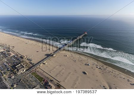 Aerial view of pier and ocean in Huntington Beach, California.