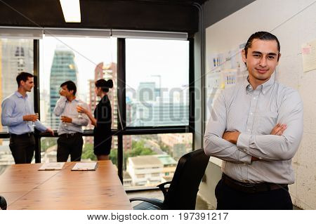 handsome businessman stand and smile look to camera in the office business meeting concept