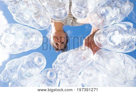 Woman recycling plastic water bottles high key looking up POV in New Zealand NZ