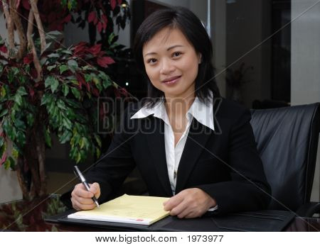 Business Woman In Conference Room