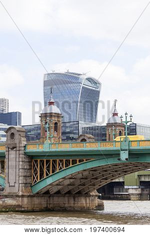 LONDON UNITED KINGDOM - JUNE 22 2017: Southwark Bridge and modern office buildings 20 Fenchurch. Business center. As of 2017 there are 17 skyscrapers in London that reach a roof height of at least 150 meters