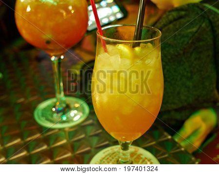 Fresh cocktail served in a night club pub bar going out fun nightlife