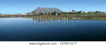 FROM CAPE TOWN, SOUTH AFRICA, MILNERTON LAGOON ON A CLEAR SUMMERS DAY, WITH TABLE MOUNTAIN IN THE BACK GROUND