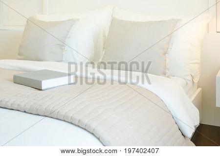 Book On Comfy Bed In Modern Bedroom Interior