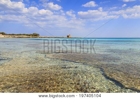 Apulia coast (Italy): Marina di Lizzano beach,Torre Sgarrata watchtower.The coastline is characterized by a alternation of sandy coves and jagged cliffs overlooking a truly clear and crystalline sea.