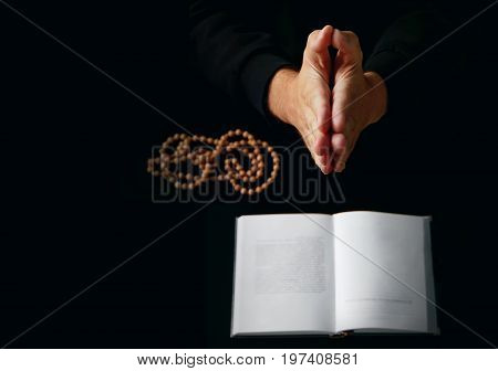 Male Hand Folded In Prayer