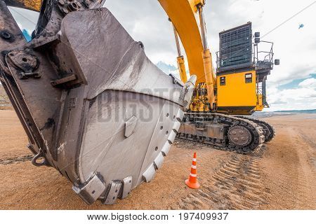 Excavator at an open pit, coal ming quarry