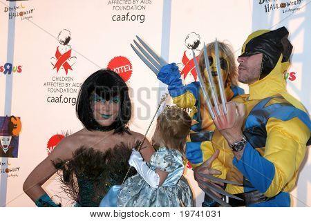 LOS ANGELES - OCT 30:  Tori Spelling, daughter Stella, son Liam, husband Dean McDermott arrive at the 17th Annual Dream Halloween at Barker Hanger on October 30, 2010 in Santa Monica, CA