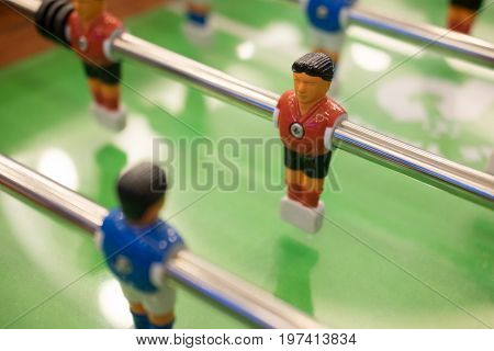 Table football game with red and blue players team in table soccer or football kicker game