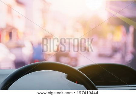 Inside Car View ,steering Wheel On Blur Traffic Road With Colorful Bokeh Light Abstract Background.