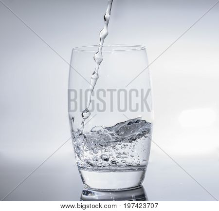 Filling water in glass - drink water in water glass