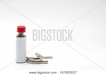 Thai herbal powder snuff in classic bottle with red cap and two snuff tube made of steel and chrome