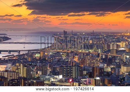 Beautiful sunset skyline background over aerial view Umeda Osaka city business downtown Japan