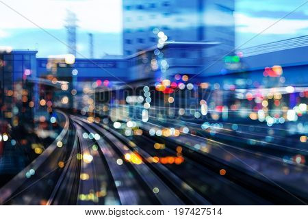 Blurred bokeh light double exposure moving traning and city light night view abstract background
