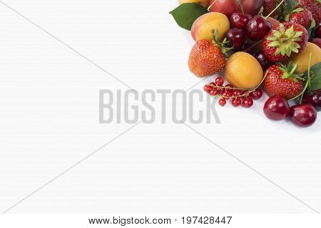 Ripe strawberries red currants apricots and cherries on white background. Berries with copy space for text. Background berries. Various fresh summer berries.