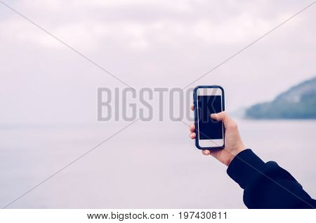 Copy Space Of Woman Hand Using Smart Phone Take Photograph At Beach Background.