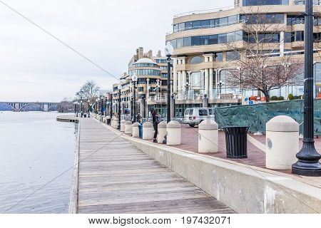 Washington Dc, Usa - March 20, 2017: Georgetown Harbor During Daytime On Riverfront With Boardwalk,
