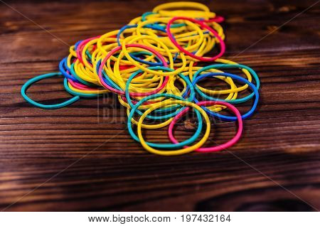 Multicolored Rubber Bands On Wooden Table