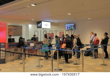 BRISBANE AUSTRALIA - JULY 10, 2017: Unidentified people visit TRS Tourist Refund Scheme counter at Brisbane International airport.