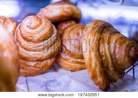 Macro Closeup Of Glazed Honey Buns On Display In Bakery