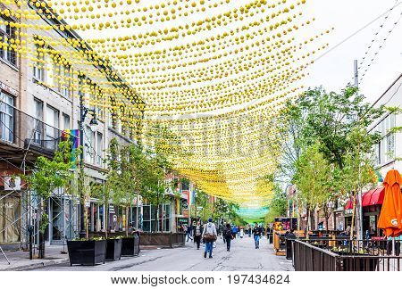 Montreal, Canada - May 26, 2017: People Walking On Sainte Catherine Street In Montreal's Gay Village