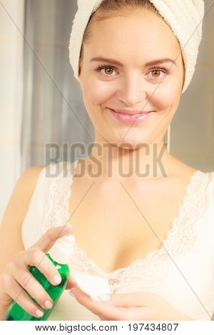 Woman With Cotton Swab Cleaning Her Skin.