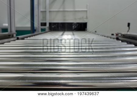 The conveyor chain and conveyor belt on production line set up in clean room area.