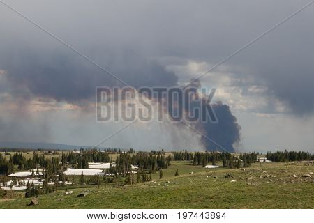Smoke and clouds from Wyoming's Keystone wildfire