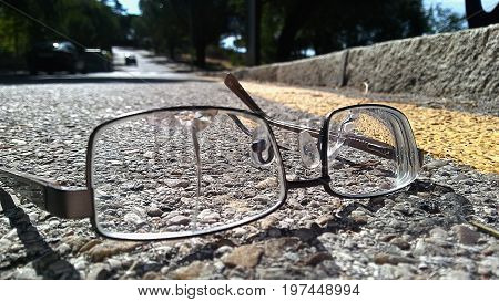 Broken glasses left on the road on a sunny summer day