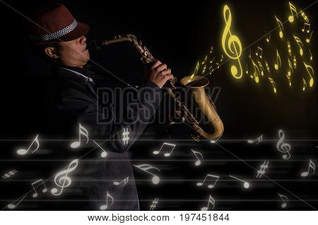 A saxophone player in a dark background with music melody musical concept