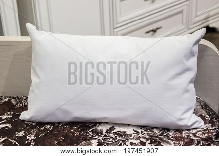 White lumbar pillow on a bed case Mockup. Interior photo.
